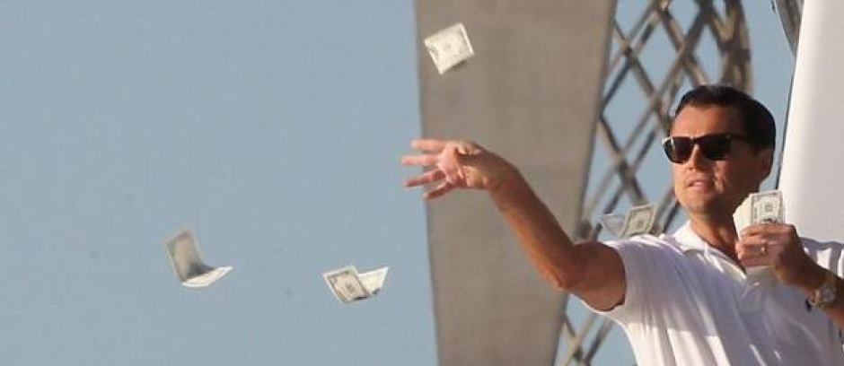 Leonardo DiCaprio in the Wolf of Wall Street literally throwing money into water